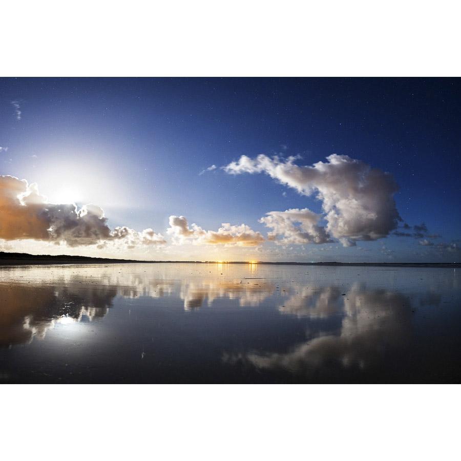Reflets de nuages sur la plage